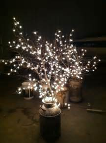 cheap wedding lighting use milk cans branches and white lights diy why spend more