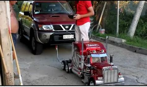 Remote Control Toy Truck Tows A Nissan Suv