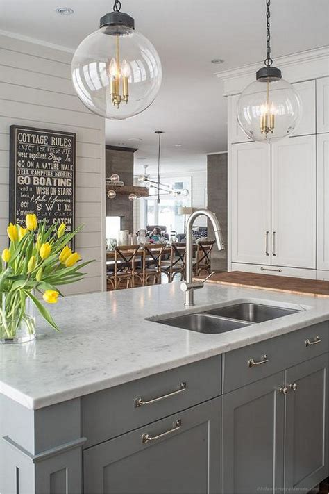 kitchens with white cabinets and black appliances white kitchen cabinets and black appliances 9861