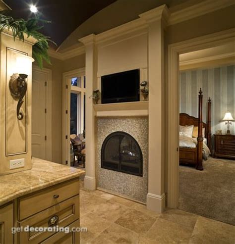 master bedroom with fireplace fireplace between bedroom and bathroom for the home