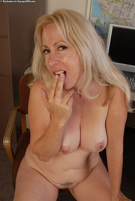 Lusty Mature blonde with Big tits posing nude And Acting Sassy In Her Office
