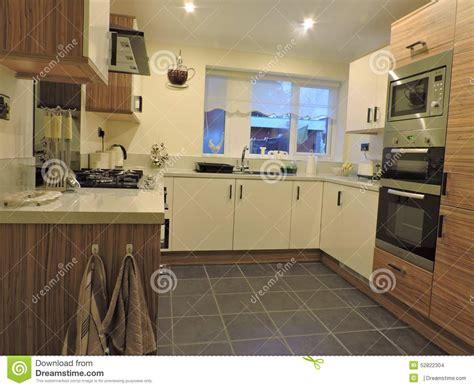 cream kitchen  wood effect  black accessories stock