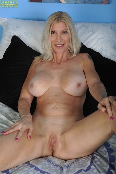 Mature Blonde Woman Cameo Removing Lingerie To Pose Nude