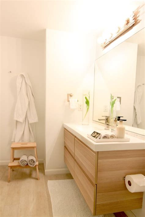ikea godmorgon vanity in white stained oak effect notice the diy custom sconce just get