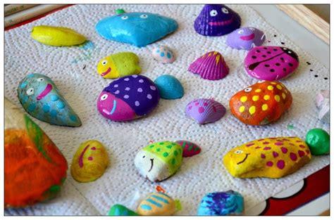 steine bemalen mit acrylfarbe bunte fisch steine do it yourself baby und meer