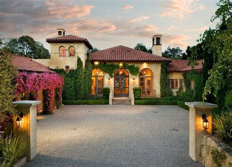 Mediterranean Exterior of Home with Arched window Transom