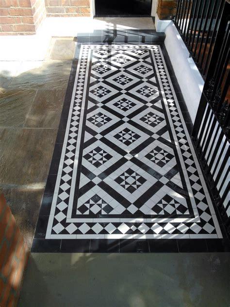 black  white victorian mosaic tile path red brick