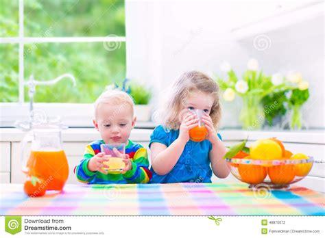 Kids Drinking Orange Juice Stock Photo