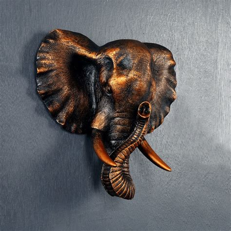 Accented with a global inspired style, the wall decor is burnished with a gray finish. Art Creative animal mural wall European living elephant head wall Pendant Zhaocai retro style ...