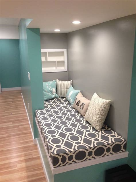 customers cozy turquoise  gray basement reading nook  cushions    home
