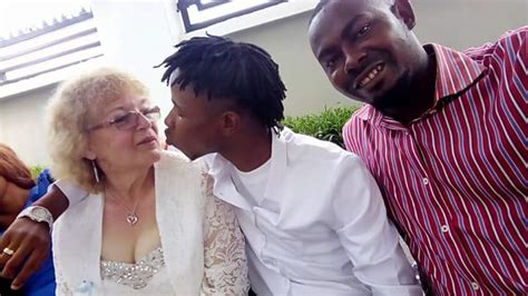 Young Nigerian Man Shows Off His Old White Bride Photos