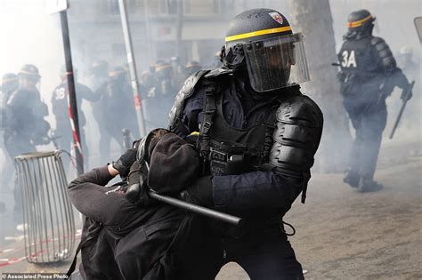 Riots break out in Paris and seven police officers are ...