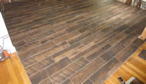 wood look plank tile installation lapse on schluter ditra with t lock
