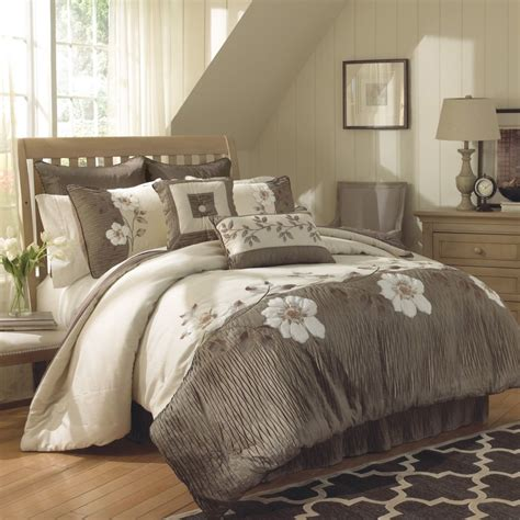 gray cream bedding set with white floral pattern placed on