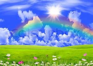 Rainbow in the dark blue sky over a summer glade | Stock ...