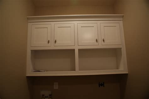 cabinets over washer and dryer boss lady 39 s ruminations painting lights and cabinets