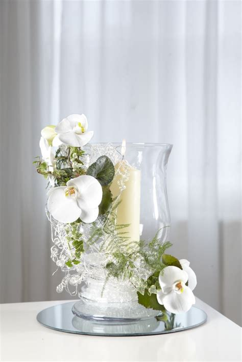 Tischgestecke In Glas by Clear Glass Hurricane Vase Teamed With Oasis 174 Mini Deco S