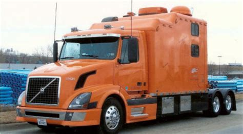 volvo big orange volvo truck with large sleeper bunk ready for the