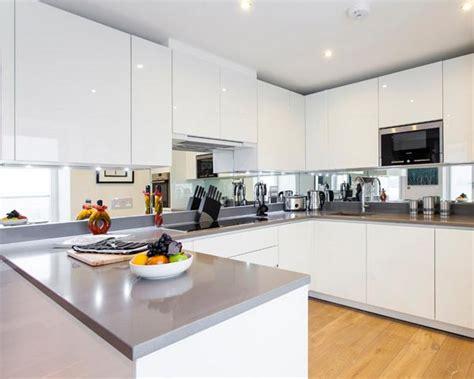 Modern And Cool Mirror Backsplash For Modern Kitchen