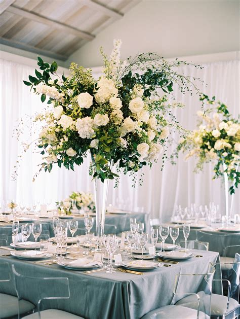 Towering white + green florals at chic indoor garden party
