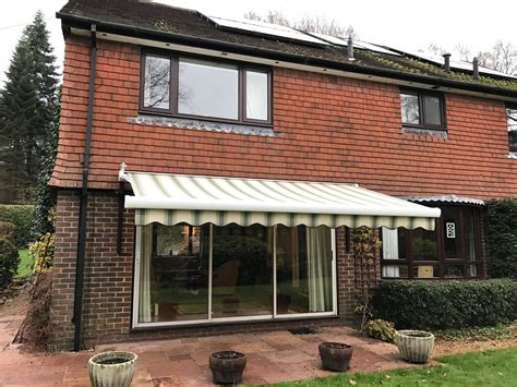 Large Electric Awning Fitted Over Patio Doors In Outdoor