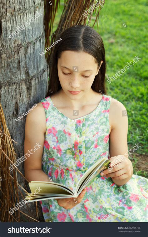 Cute Teen Girl Reading Book Sitting Stock Photo 302981786
