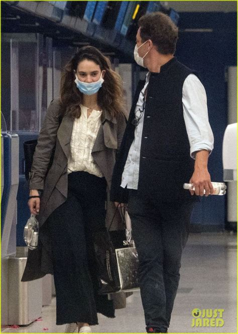 lily james dominic west cuddle  airport  pda pics