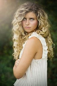 Girl with Blonde Curly Hair