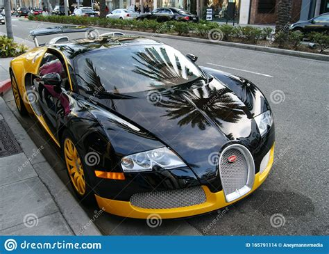 Another custom order, this car was specified this made the bugatti veyron grand sport vitesse price among the most expensive bugattis ever. Bugatti Veyron Parked Outside The House Of Bijan On Rodeo Drive, Beverly Hills Editorial Stock ...