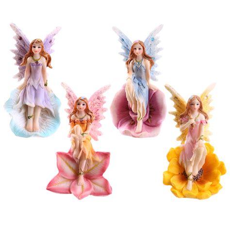 flower fairy sitting in flower head 9772 puckator ltd