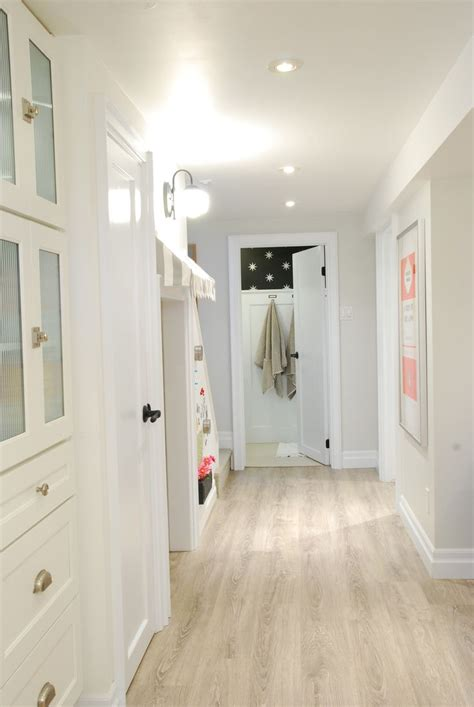 light colored wood floors basement white bright rambling renovators pinterest lighting the floor and laminate