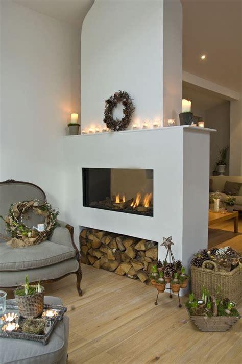 two sided fireplace houtblokken opbergen interieur insider