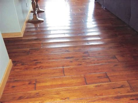 hardwood floor buckled water wood laminate buckling types of wood