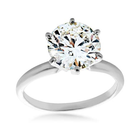 3ct A Quality Diamond Solitaire Engagement Ring. Celeb Engagement Rings. Girls Chains. Multi Row Necklace. Daisy Diamond. Bow Tie Chains. 4 Carat Rings. Tassel Rings. Clear Diamond