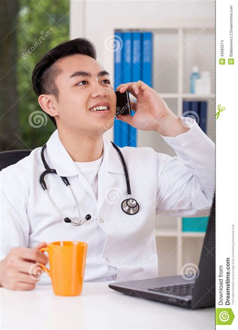the phone doctor doctor talking on the phone stock photo image 42983274