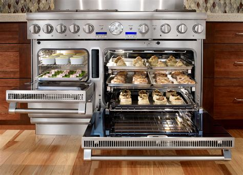 Musthave Thermador's Pro Grand Steam Range, Reviewed. Wall Toilet. White Chandeliers. Retro Kitchen. Industrial Counter Stools. Dish Racks. French Closet Doors. Royal Closet. Who Makes The Best Quality Sofas