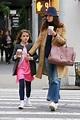 Katie Holmes and lookalike daughter Suri walk hand-in-hand ...