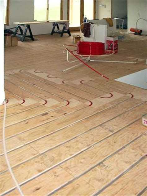 ThermoFin U and PEX tubing with plywood sleepers are