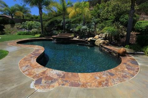 fireplace surround ideas and eye catching 60 spectacular kidney shaped swimming pools for your patio