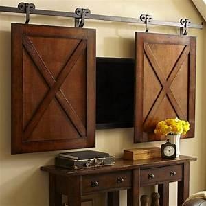 hiding your tv 29 trendy panels and doors ideas digsdigs With barn doors to hide tv