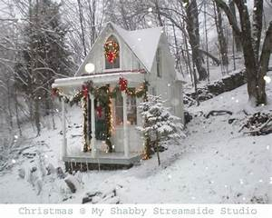 Little white cottage in the woods decorated for Christmas ...