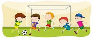 Boy Playing Football At Field