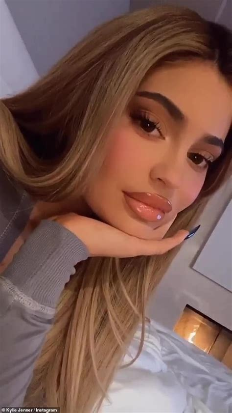 Kylie Jenner shows off her extra glossy lips while ...