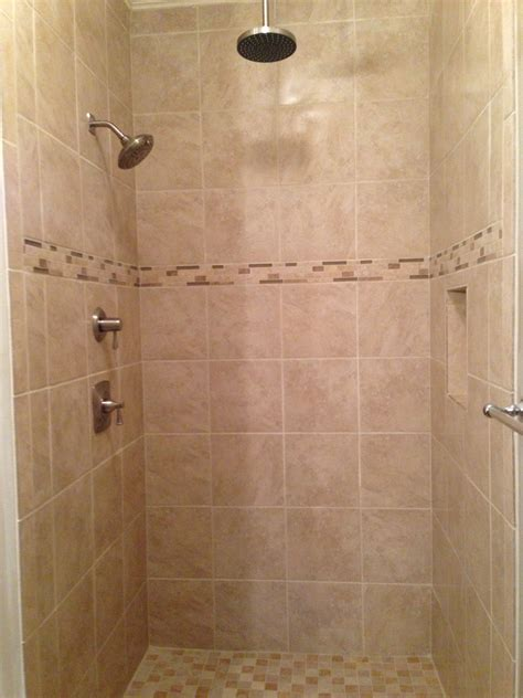 light beige tile shower with rain head shower fixture