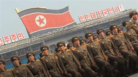 north korea issues fresh threat  guam  hand