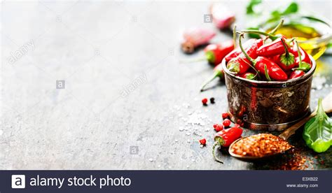 cuisine concept chili peppers with herbs and spices wooden
