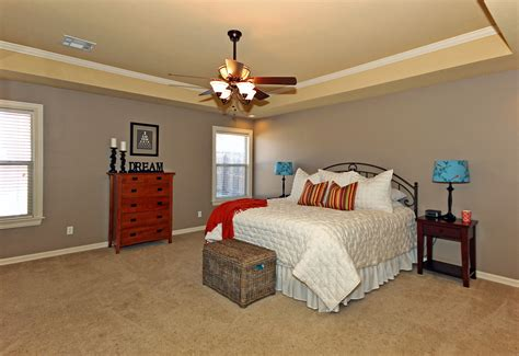 large master bedroom with tray ceilings crown molding a