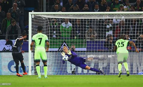 Joe Hart of Manchester City saves the penalty from Raffael ...