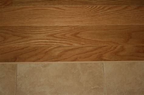 tile flooring next to hardwood porcelain tile floor next to hardwood floor used laticrete s latisil in toasted almond same
