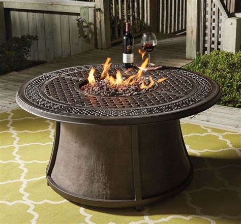 Then get this rectangle patio propane fire pit. Burnella Round Fire Pit Table | Round fire pit table, Gas fire pit table, Fire pit furniture